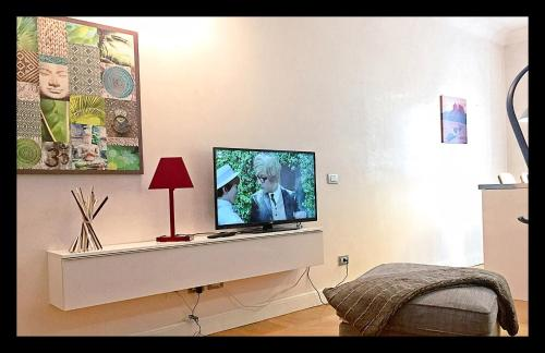 A television and/or entertainment center at Brera suite by MB rent