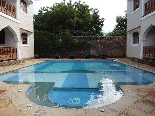 The swimming pool at or near The Diani Pearl