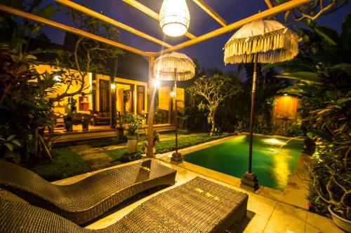 The swimming pool at or close to Villa Ulun Mertha - 1BR Private Villa