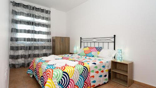 A bed or beds in a room at Apartamento Bene I
