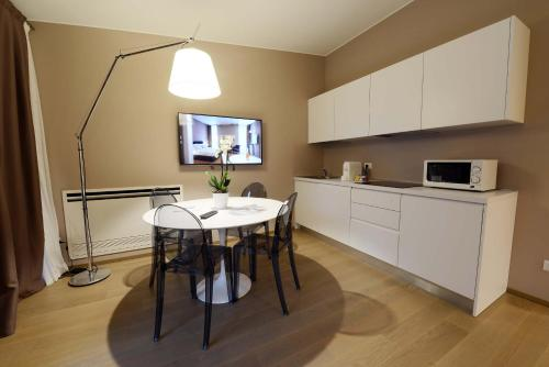 A kitchen or kitchenette at MyPlace Corso Como 11 Apartments