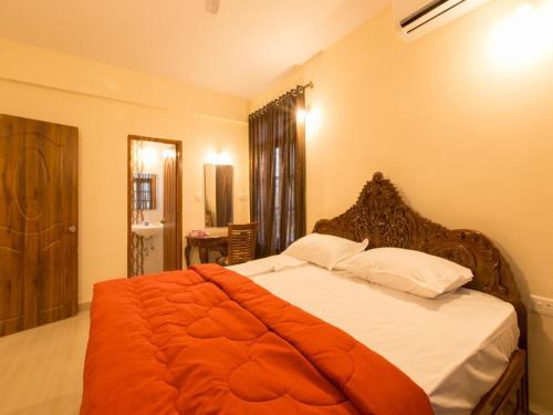 Кровать или кровати в номере Saudades Homestays