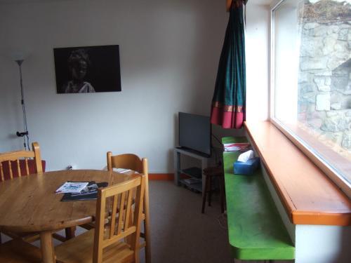 Een TV en/of entertainmentcenter bij Les Arcosses