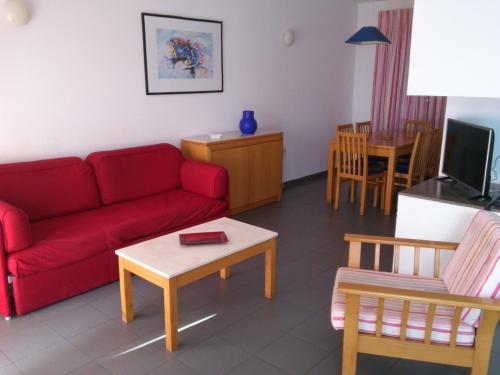 Uma área de estar em Quinta Das Figueirinhas & Quintinha Village