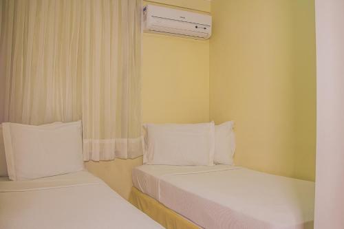 Cama ou camas em um quarto em Adaba Blue Ocean Flat
