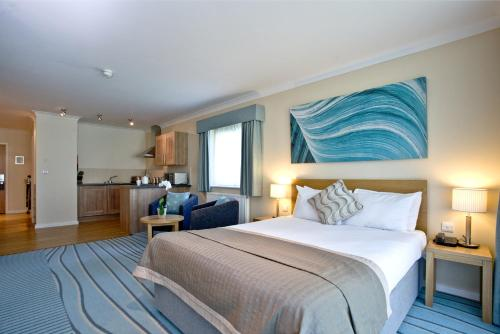 A bed or beds in a room at De Vere Cotswold Water Park Apartments