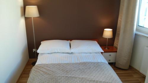 Gulta vai gultas numurā naktsmītnē Apartament Sokołowska