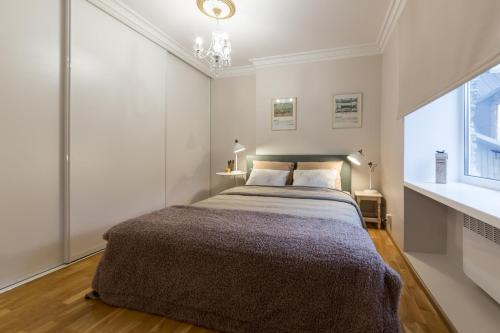 A bed or beds in a room at Best Apartments - Viru