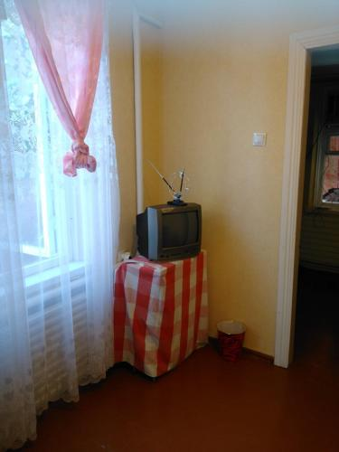 A television and/or entertainment center at Hostel Uyutny