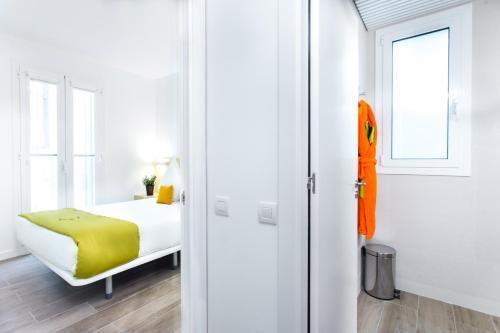 Cama o camas de una habitación en Cosmo Apartments Marina – Auditori
