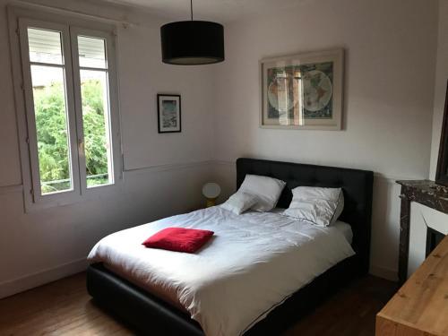 Un ou plusieurs lits dans un hébergement de l'établissement Belle maison familliale