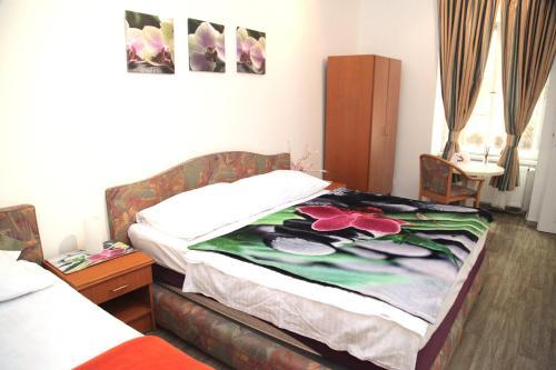 Łóżko lub łóżka w pokoju w obiekcie Prague Trendy- Apartments