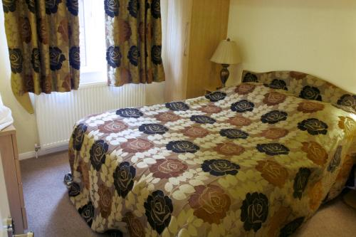 A bed or beds in a room at Royal Deeside Woodland Lodges