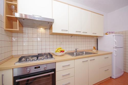 Kuchyň nebo kuchyňský kout v ubytování Apartments Imgrund