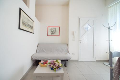 A bed or beds in a room at Casetta Rossa
