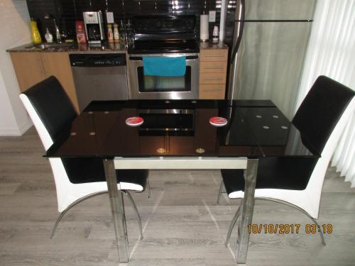 A television and/or entertainment center at Luxury Furnished Corporate Suite in Downtown Toronto
