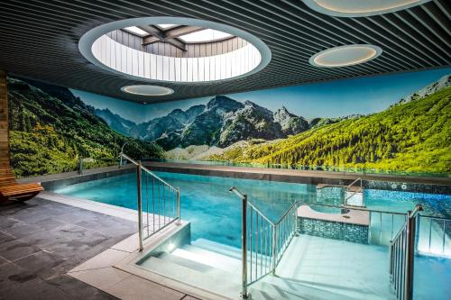 The swimming pool at or close to Giewont Aparthotel