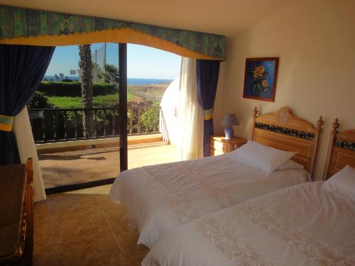 A bed or beds in a room at Clansani Tenerife