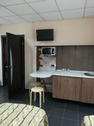 A television and/or entertainment center at А 54 Hostel