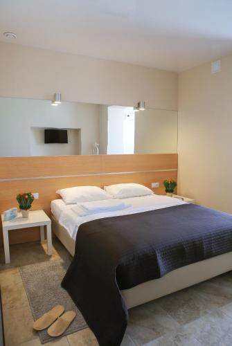Кровать или кровати в номере Welcome Inn
