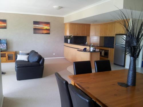 A kitchen or kitchenette at Boardwalk By The Beach