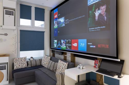 A television and/or entertainment center at Louvre Luxury Apartment & SPA