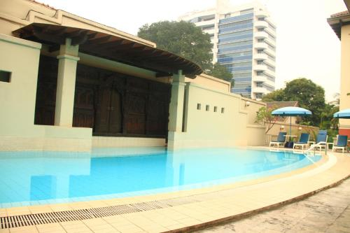The swimming pool at or near Aditya Mansions Apartment