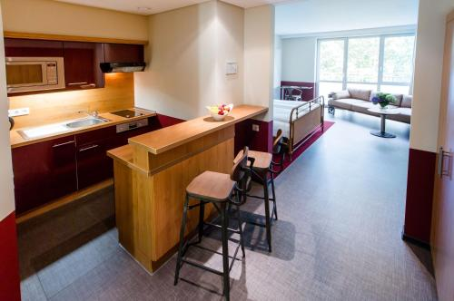 A kitchen or kitchenette at Aparion Apartments Berlin