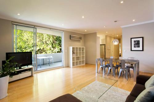 A television and/or entertainment center at Two Bedroom Apartment Wigram Road(GLE20)
