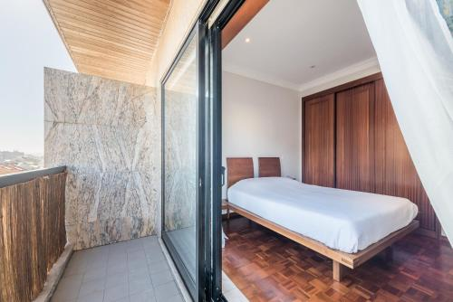 A bed or beds in a room at TPC Tullins Palmeira