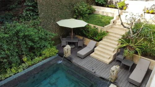 A view of the pool at Villa Purnamasari or nearby