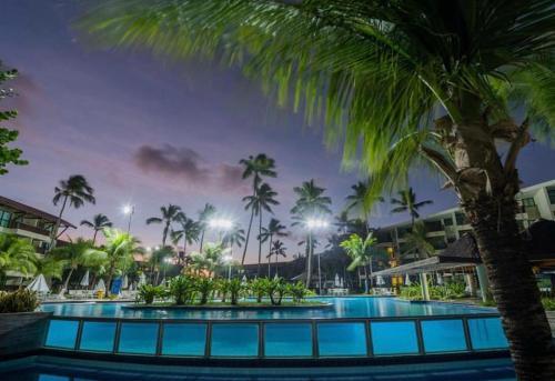 The swimming pool at or near Flats Resort Porto Beach