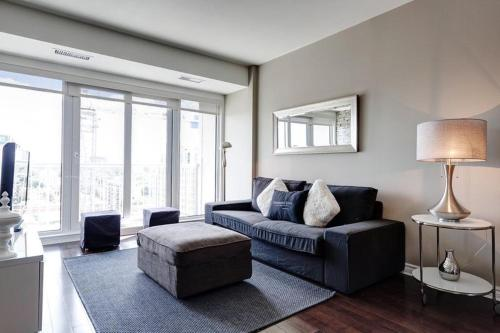 A seating area at 50 Laurier Apartments by Corporate Stays