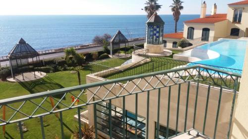 A balcony or terrace at SEA ESCAPE - Live Over The Sea