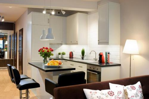A kitchen or kitchenette at Apartament Feeria Kraków