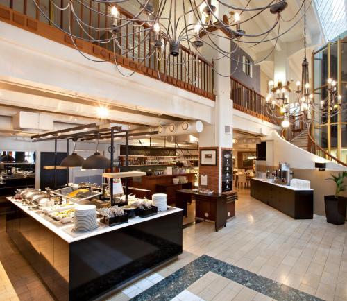 En restaurang eller annat matställe på Holiday Club Tampere Spa Apartments