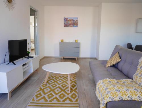 Ein Sitzbereich in der Unterkunft La Petite Venise
