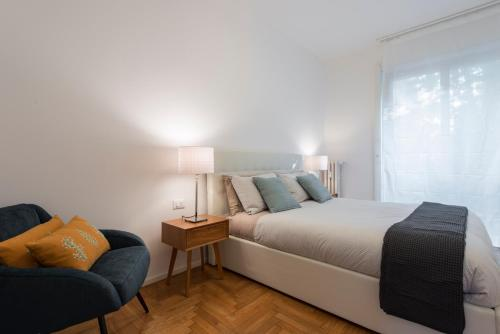 A bed or beds in a room at Mila Apartments Via Savona