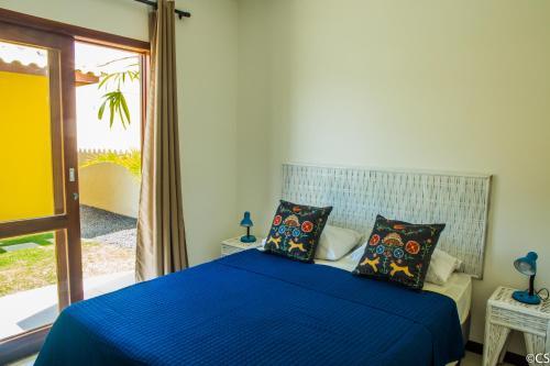Cama ou camas em um quarto em Atlantica Apartamentos Imbassai