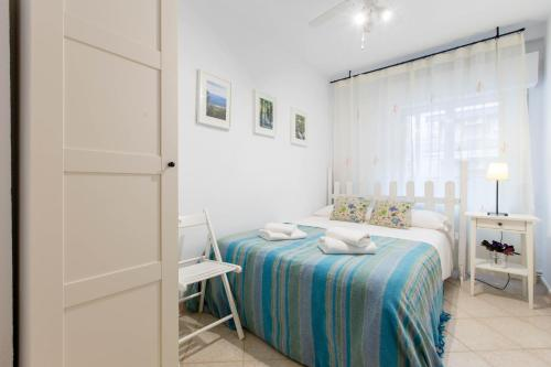 A bed or beds in a room at Lucero Madrid