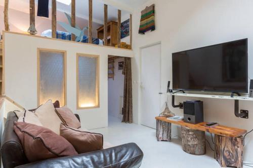 Ein Sitzbereich in der Unterkunft Maison North West Paris