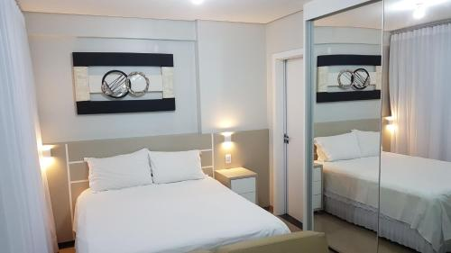 A bed or beds in a room at Flat Smart Residence