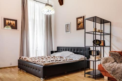 A bed or beds in a room at Art Apartments Ruzova
