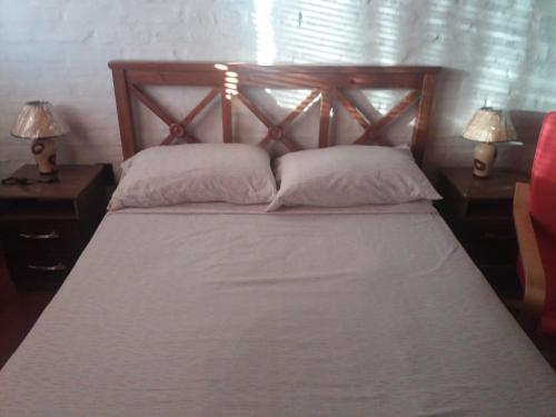 A bed or beds in a room at Apartamento San Martin