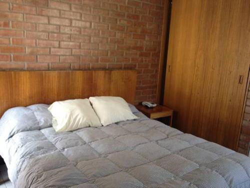 Cama o camas de una habitación en Aparthotel San Francisco