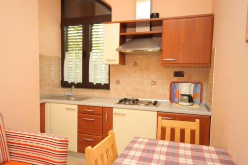 A kitchen or kitchenette at Apartment Rovinj 7195e