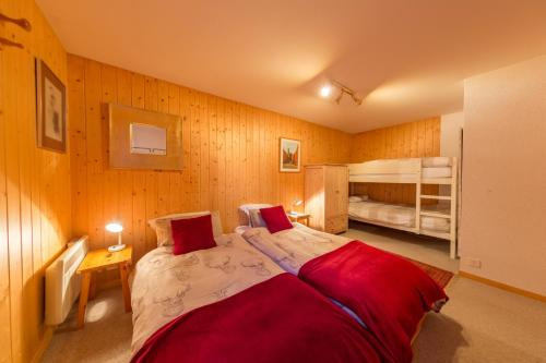A bed or beds in a room at Chalet Marianne - Close to ski lift Nendaz - 4 Valleys