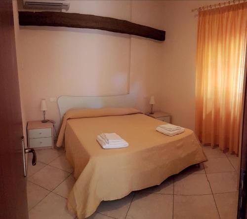 Letto o letti in una camera di L' Arcobaleno Resort