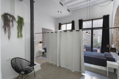 Ein Sitzbereich in der Unterkunft ApartEasy - Eixample LOFT - 3 Open Bedrooms