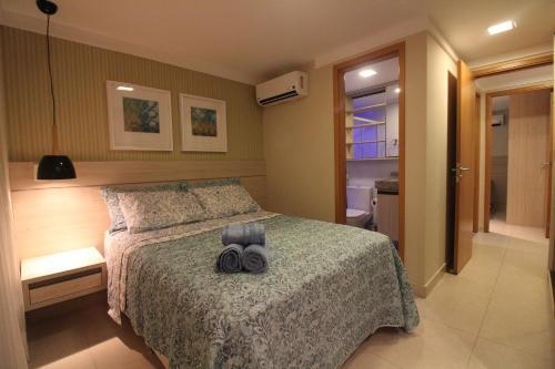 A bed or beds in a room at Luxor Paulo Miranda Home Service